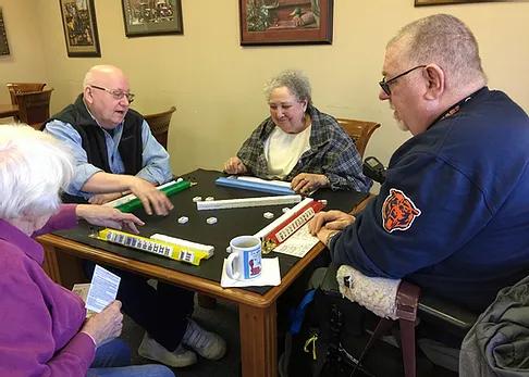 4 seniors playing a game